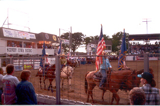"""Sidney Iowa Rodeo - taken in 2005, this is the opening of the events """"The Grand Entry""""."""