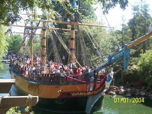 "Pirates of the Carribean-Disneyland - This is a picture of the ride at Disneyland for the Disney movie the Pirates of the Carribean. I had a great time there and I recommend it to fans of the movie and of Disney. It is fun how the pirates on board do not get out of character during the ride, so, if you ask them for example, to take a picture of you or with them, they will act like they don't know what a camera is and try to barter it for gold from someone else. Also, it is very fun to here them speak of some place called ""Dis-NAY,"" that they are trying to avoid. Lots of fun..."